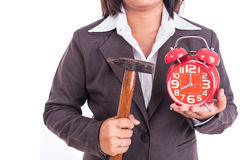 Woman holding hammer and red alarm clock isolated on white. Brea Royalty Free Stock Photo
