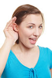 Woman holding hand behind her ears Stock Photos
