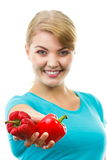 Woman holding in hand fresh and wrinkled peppers, white background Royalty Free Stock Photo