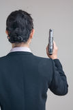 Woman holding a hand gun Stock Image
