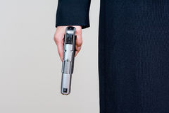 Woman holding a hand gun Stock Images