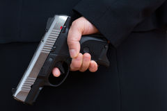 Woman holding a hand gun Royalty Free Stock Photography