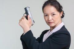 Woman holding a hand gun Royalty Free Stock Photos
