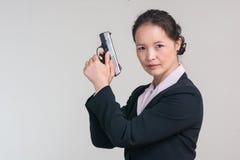 Woman holding a hand gun Stock Photos
