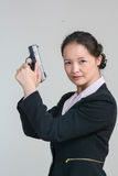 Woman holding a hand gun Royalty Free Stock Images