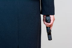 Woman holding hand gun on white background Stock Images