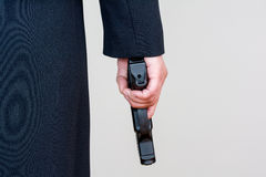 Woman holding hand gun on white background Royalty Free Stock Photos