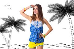 Woman holding hand on her head. Young smiling woman in blue T-shirt and yellow shorts holding hand on her head on white background in studio Stock Image