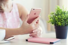 Woman holding in the hand iPhone6S Rose Gold. Alushta, Russia - October 27, 2015: Woman holding in the hand iPhone6S Rose Gold. iPhone 6S Rose Gold was created royalty free stock image