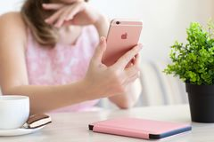 Woman holding in the hand iPhone6S Rose Gold. Alushta, Russia - October 27, 2015: Woman holding in the hand iPhone6S Rose Gold. iPhone 6S Rose Gold was created royalty free stock photography