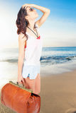 Woman holding hand luggage, summer travel. Woman holding hand luggage. Summer travel. Blue sea and sandy beach at Bali. Vacation rentals. Airport. Terminal Stock Images