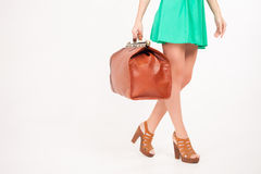 Woman holding hand luggage, weight and baggage dimensions Stock Photos