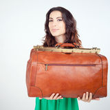 Woman holding hand luggage, weight and baggage dimensions Royalty Free Stock Images