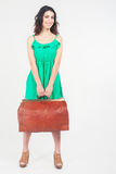 Woman holding hand luggage, weight and baggage dimensions Stock Image