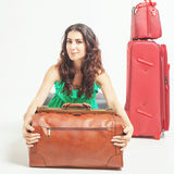 Woman holding hand luggage, weight and baggage dimensions Royalty Free Stock Photos
