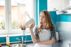 Woman holding hand mixer Royalty Free Stock Image