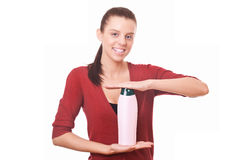 Woman holding in hand shampoo Royalty Free Stock Image