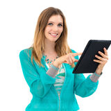 Woman holding in hand a tablet touch pad Royalty Free Stock Photos