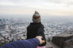 Woman holding hand at viewpoint Stock Photo