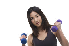Woman holding hand weights. Fit Asian woman using hand weights Royalty Free Stock Photography