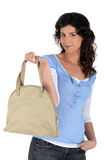 Woman holding handbag Royalty Free Stock Photography