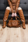 Woman holding a handbag Royalty Free Stock Photography