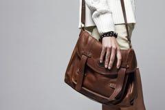 Woman holding handbag, focus on the handbag Stock Photos