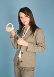 Woman holding a handcuffs Royalty Free Stock Photography