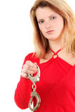 Woman holding handcuffs Stock Images