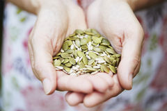 Woman Holding Handful Of Nuts And Seeds Royalty Free Stock Photos