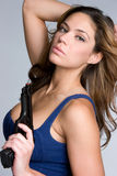 Woman Holding Handgun. Pretty young woman holding handgun Royalty Free Stock Images