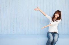 Woman holding hands with blue background Royalty Free Stock Photo
