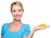 Woman holding in hands the cantle of  orange Stock Image