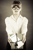 Woman holding in hands contract and chain with padlock Royalty Free Stock Photography
