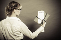 Woman holding in hands contract and chain with padlock Stock Photo