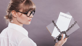 Woman holding in hands contract and chain with padlock Stock Photography