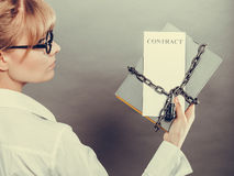 Woman holding in hands contract and chain with padlock Stock Images