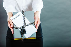 Woman holding in hands contract and chain with padlock Royalty Free Stock Image