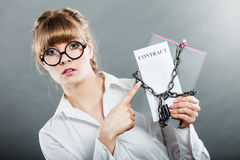 Woman holding in hands contract and chain with padlock Royalty Free Stock Photo