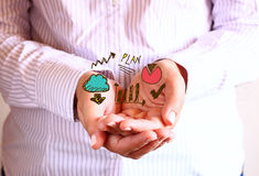 Woman holding hands in cupped shape and drawing of charts and infographics. close up image with selective focus. Business concept Royalty Free Stock Photos