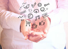 Woman holding hands in cupped shape and drawings of charts and infographics. Close up image with selective focus. Business concept Royalty Free Stock Photos