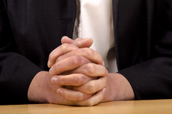 Woman holding hands folded for prayer Royalty Free Stock Photos