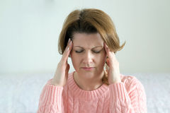 Woman holding hands on  head, depression, pain, migraine Stock Image