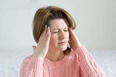 Woman holding hands on  head, depression, pain, migraine Stock Photo