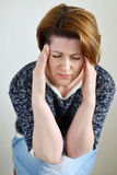 Woman holding hands on  head, depression, pain, migraine Stock Images