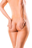 Woman holding with hands her bare ass Stock Photos