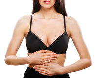 Woman holding hands on stomach. Isolated on white Stock Photo