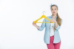 Woman holding hanger Stock Photo