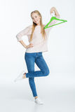 Woman holding hanger Royalty Free Stock Photography