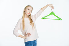 Woman holding hanger Royalty Free Stock Image